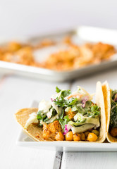 Chickpea Cauliflower Vegan Tacos with Cabbage Slaw Mexican Food on a Crisp White Wooden Background