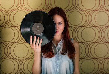 Woman Holding Vinyl Against her Face