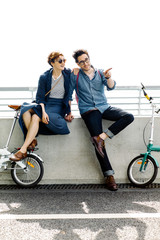 Cheerful couple spending time with bicycles