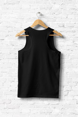 Black Tank Top Shirt Mock-up hanging on white wall, rear side view. 3D rendering.