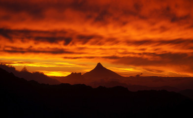 Sky on fire with mordor like volcano at sunset in Nahuel Huapi National Park, Argentina. Fototapete