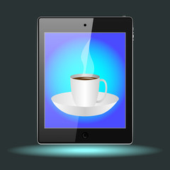 tablet with a Cup on a saucer with a hot drink