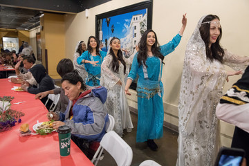 Traditional musicians and dancers entertain as Iranian-American volunteers cook and serve food for homeless and near-homeless people at Midnight Mission shelter on Skid Row to celebrate Nowruz, Iranian New Year in Los Angeles