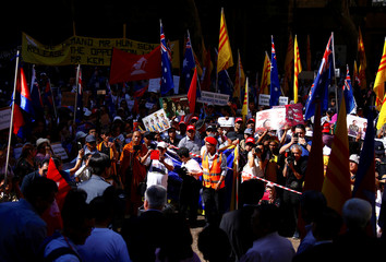 Protesters hold placards and chant slogans during a demonstration against government officials attending the one-off ASEAN summit in Sydney