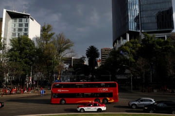 One of the dozens of British double-decker buses, which is part of a one billion peso deal with Britain to help the sprawling capital tackle traffic and pollution, drives through Mexico City, Mexico