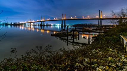 The Golden Ears Bridge, conecting Maple Ridge to Langley. Long exposure at night, reflecting into Fraser River.