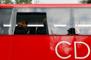 Commuters ride on one of dozens of British double-decker buses, which is part of a one billion peso deal with Britain to help the sprawling capital tackle traffic and pollution in Mexico City, Mexico