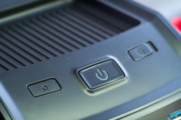 Green power button. Closeup shot.