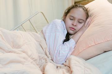 Mixed race tween girl in hospital bed