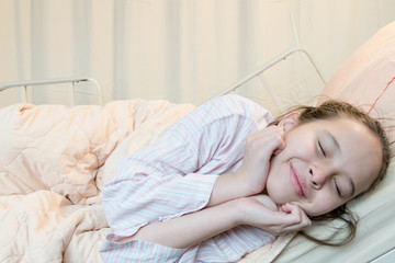 Cheerful  mixed race tween girl in hospital bed