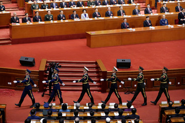 Members of Chinese honor guard leave after an oath-taking ceremony to the Chinese Constitution at the fifth plenary session of the National People's Congress (NPC) at the Great Hall of the People in Beijing