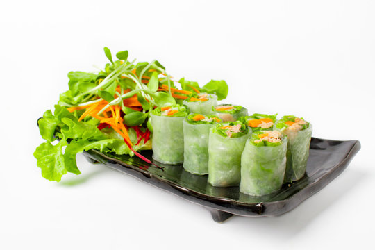 Fresh Tuna spring roll, traditional vietnamese food serve with mix vegetable in black plate on white background