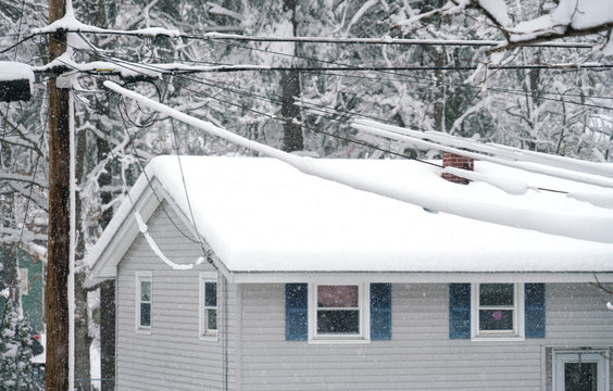 power line and residential house in the snow storm