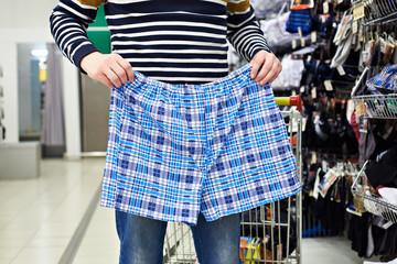 Man chooses panties in store