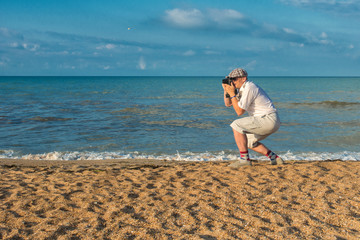 Photographer on a beach