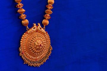 A golden necklace, Pune