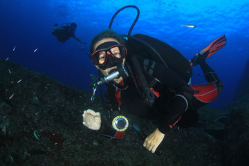 Female scuba diver underwater and fish