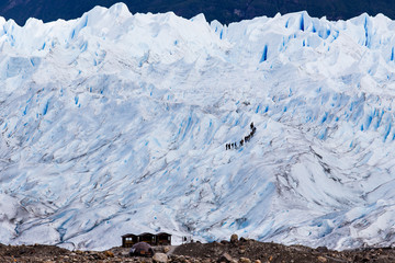 People climbing glacier, telephoto view, holiday travel. Global