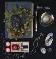 Occult altar with Pan's face, wreath of hops