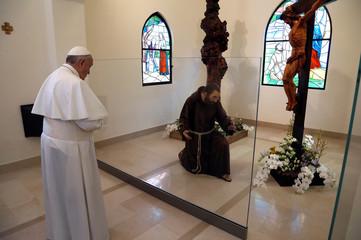 Pope Francis prays inside the San Francesco chapel in Pietrelcina