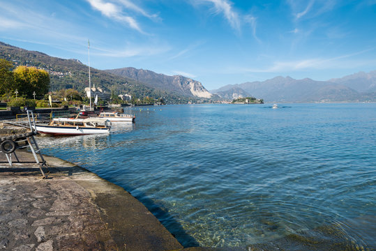 Stresa, Lake Maggiore, Italy. Lakeside of Stresa, in the middle, the island Bella and in the background the Alps. Picturesque view of the Borromean Gulf, famous tourist destination in Italy
