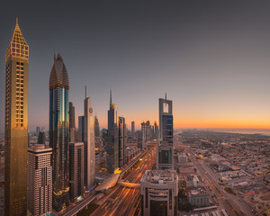 Dubai downtown skyline at beautiful golden sunset