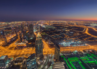 Panorama of Dubai cityscape from above at sunrise