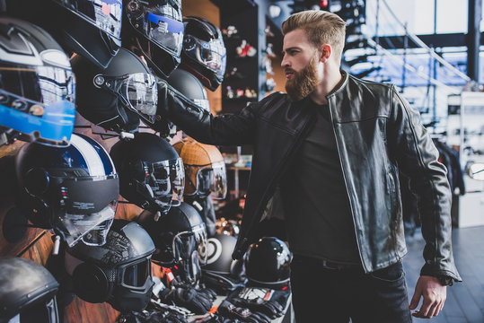 Man in motorcycle shop