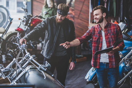 Men in motorcycle shop