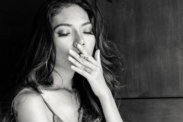 Fashion portrait of  beautiful woman sexy slim body smoking cigarette