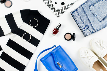 Casual style woman clothes and fashion accessories flat lay. Trendy patterns and prints concept.