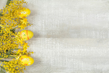 Easter holiday composition in yellow colors with spring flowers.