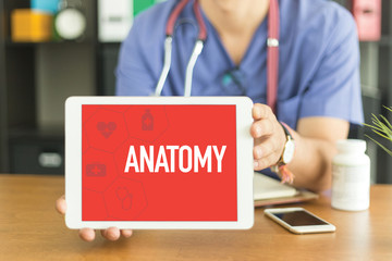 Young and professional medical doctor showing a tablet pc and ANATOMY concept on screen