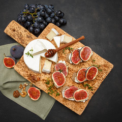Bruschetta with blue cheese, brie and fresh figs