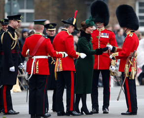 Britain's Catherine, Duchess of Cambridge holds shamrock, as Prince Wiliam looks on, at the presentation of Shamrock to the 1st Battalion Irish Guards, at a St Patrick's Day parade at Cavalry Barracks in Hounslow, London