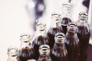 Refreshing Brown Soda in bottles in Candy Bar On Table