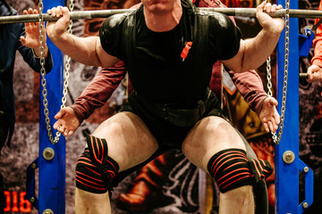 powerlifter in knee wraps exercise squat powerlifting