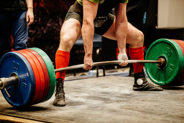 powerlifter exercise deadlift  heavy weight in powerlifting competition