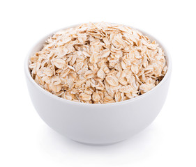 Oat flakes pile in white bowl on white background