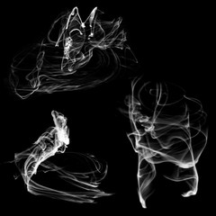 Shapeless smoke jets for design on a black background.