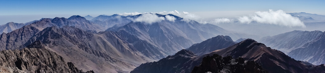 Panorama of Toubkal and other highest mountain peaks of High Atlas mountains in Toubkal national park, Morocco, North Africa Wall mural