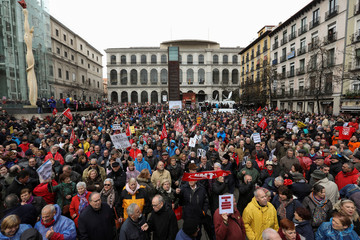 People gather during a demonstration demanding higher state pensions, in Madrid