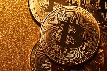 Bitcoin over golden glitter background. Business concept. Wall mural