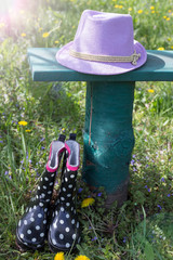 Rubber boots, hat on bench