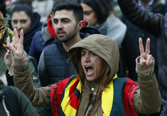 People attend a demonstration organised by Kurds in Hanover