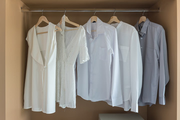 white color shirts hanging on rail