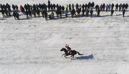 An aerial view shows a rider competing in an amateur horse race near Krasnoyarsk