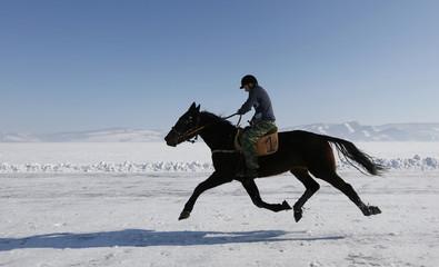 A rider competes in an amateur horse race near Krasnoyarsk