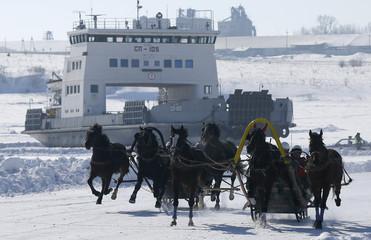 Russian Troikas compete during an amateur horse race near Krasnoyarsk