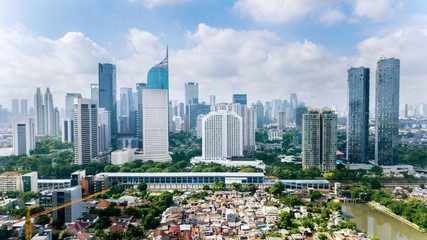 Panoramic view of Jakarta cityscape with residential houses, modern office and apartment buildings Wall mural